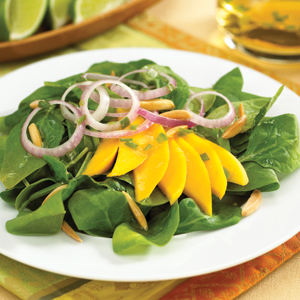 SPINACH–MANGO SALAD WITH HOT AND SOUR DRESSING